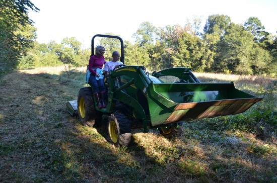 mom and dad on the tractor