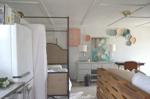 Cool We put a Queen size canopy bed in the corner where there was once two mismatched twin beds