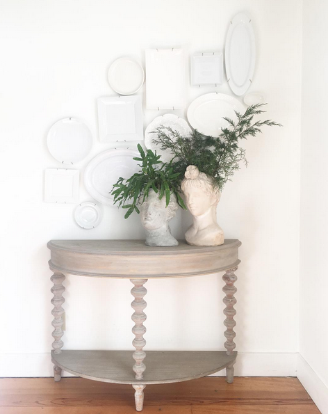 heres what i had there before i love this little half moon table and i loved the white plate display but i wanted something that could double as a desk